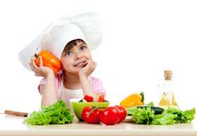 Chef girl preparing healthy food vegetable salad over white back